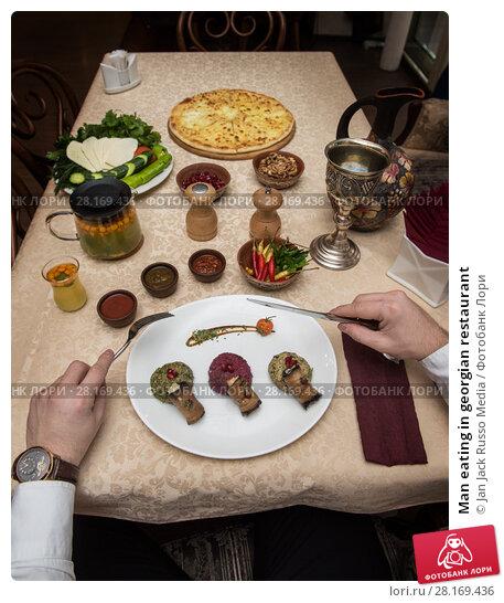 Купить «Man eating in georgian restaurant», фото № 28169436, снято 21 декабря 2016 г. (c) Jan Jack Russo Media / Фотобанк Лори