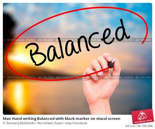 Купить «Man Hand writing Balanced with black marker on visual screen», фото № 28150344, снято 20 июня 2018 г. (c) easy Fotostock / Фотобанк Лори