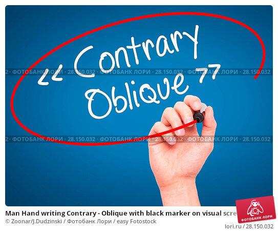 Купить «Man Hand writing Contrary - Oblique with black marker on visual screen», фото № 28150032, снято 18 июня 2018 г. (c) easy Fotostock / Фотобанк Лори