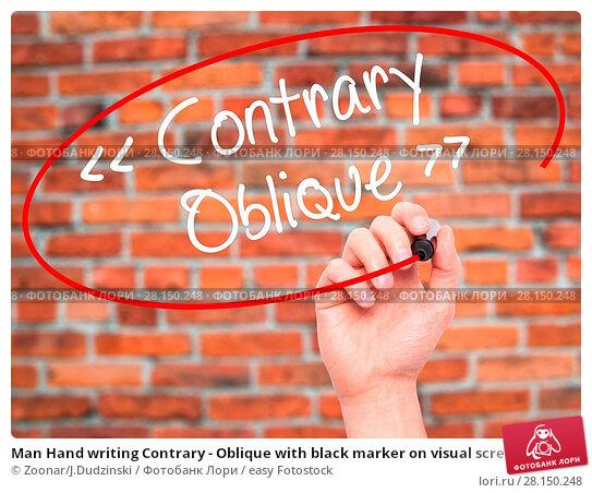 Купить «Man Hand writing Contrary - Oblique with black marker on visual screen», фото № 28150248, снято 21 июня 2018 г. (c) easy Fotostock / Фотобанк Лори