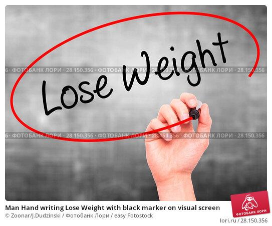 Купить «Man Hand writing Lose Weight with black marker on visual screen», фото № 28150356, снято 19 июня 2018 г. (c) easy Fotostock / Фотобанк Лори