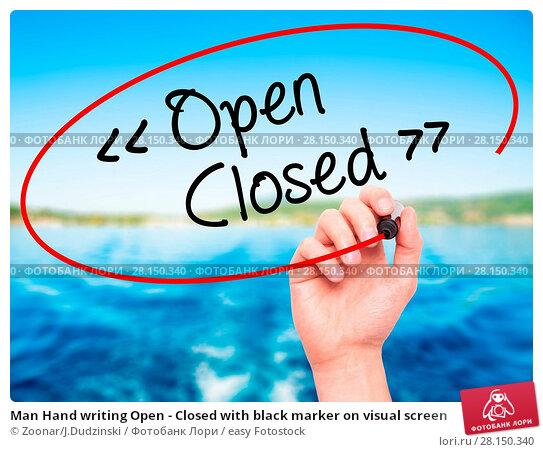 Купить «Man Hand writing Open - Closed with black marker on visual screen», фото № 28150340, снято 20 июня 2018 г. (c) easy Fotostock / Фотобанк Лори