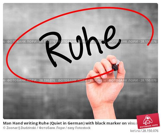 Купить «Man Hand writing Ruhe (Quiet in German) with black marker on visual screen», фото № 28150076, снято 21 июня 2018 г. (c) easy Fotostock / Фотобанк Лори