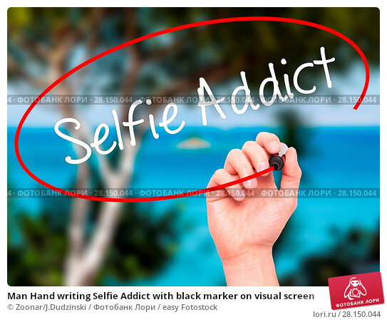 Купить «Man Hand writing Selfie Addict with black marker on visual screen», фото № 28150044, снято 19 июня 2018 г. (c) easy Fotostock / Фотобанк Лори