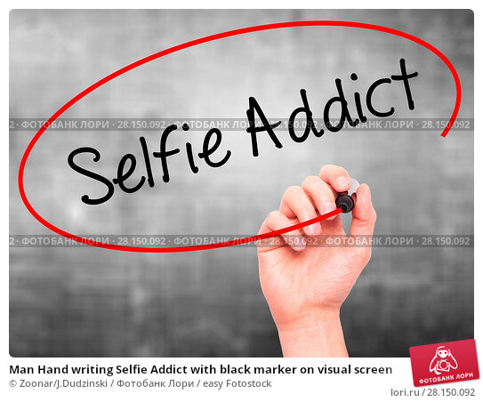 Купить «Man Hand writing Selfie Addict with black marker on visual screen», фото № 28150092, снято 19 июня 2018 г. (c) easy Fotostock / Фотобанк Лори