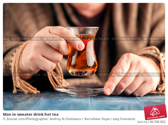 Man in sweater drink hot tea. Стоковое фото, фотограф Zoonar.com/Photographer: Andrey N.Cherkasov / easy Fotostock / Фотобанк Лори