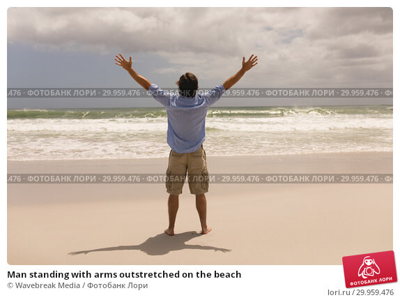 Купить «Man standing with arms outstretched on the beach », фото № 29959476, снято 6 ноября 2018 г. (c) Wavebreak Media / Фотобанк Лори