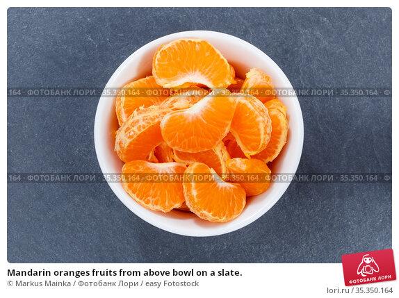 Mandarin oranges fruits from above bowl on a slate. Стоковое фото, фотограф Markus Mainka / easy Fotostock / Фотобанк Лори