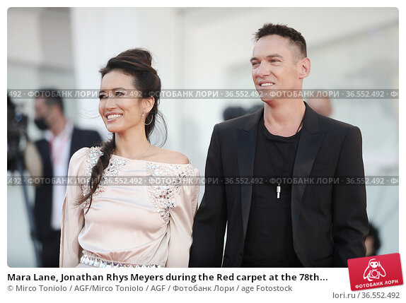 Mara Lane, Jonathan Rhys Meyers during the Red carpet at the 78th... Редакционное фото, фотограф Mirco Toniolo / AGF/Mirco Toniolo / AGF / age Fotostock / Фотобанк Лори