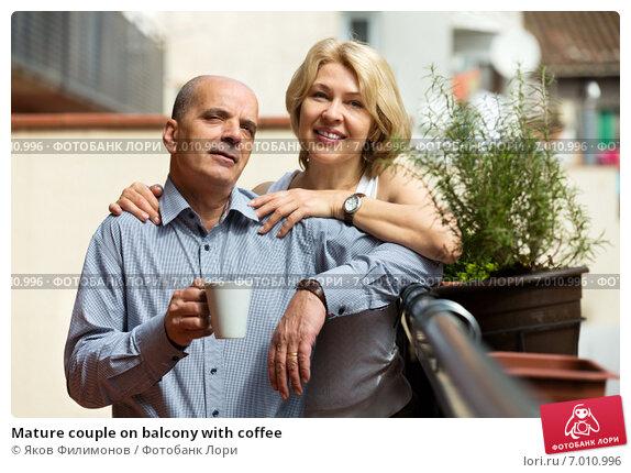 Купить «Mature couple on balcony with coffee», фото № 7010996, снято 28 мая 2014 г. (c) Яков Филимонов / Фотобанк Лори