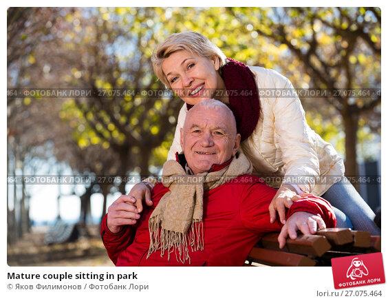 Купить «Mature couple sitting in park», фото № 27075464, снято 16 января 2018 г. (c) Яков Филимонов / Фотобанк Лори