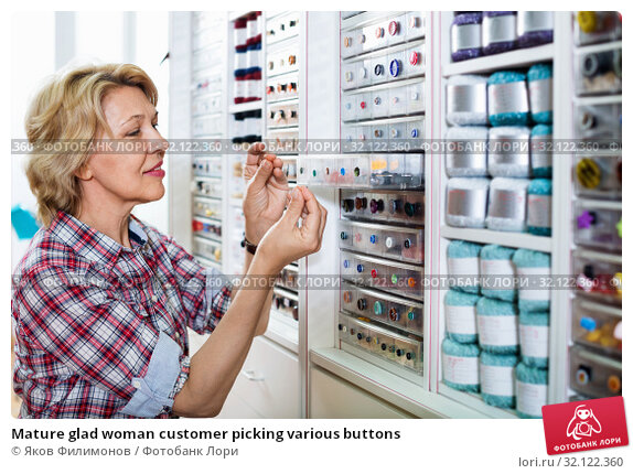 Купить «Mature glad woman customer picking various buttons», фото № 32122360, снято 7 июля 2020 г. (c) Яков Филимонов / Фотобанк Лори