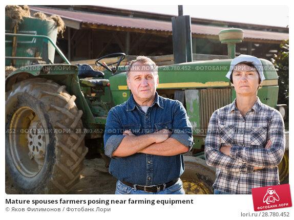 Купить «Mature spouses farmers posing near farming equipment», фото № 28780452, снято 24 октября 2017 г. (c) Яков Филимонов / Фотобанк Лори