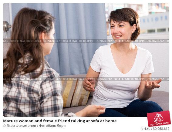 Купить «Mature woman and female friend talking at sofa at home», фото № 30968612, снято 16 июля 2019 г. (c) Яков Филимонов / Фотобанк Лори