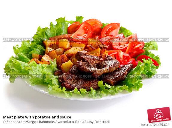 Meat plate with potatoe and souce. Стоковое фото, фотограф Zoonar.com/Sergejs Rahunoks / easy Fotostock / Фотобанк Лори