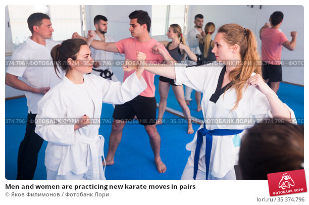Men and women are practicing new karate moves in pairs. Стоковое фото, фотограф Яков Филимонов / Фотобанк Лори