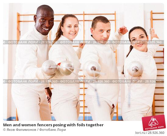 Купить «Men and women fencers posing with foils together», фото № 28926360, снято 11 июля 2018 г. (c) Яков Филимонов / Фотобанк Лори