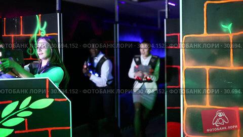Купить «Men and women in business suits playing laser tag emotionally in dark room», видеоролик № 30694152, снято 20 июня 2019 г. (c) Яков Филимонов / Фотобанк Лори