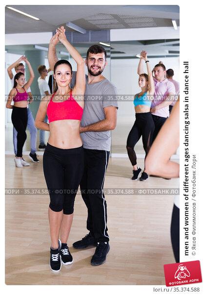 men and women of different ages dancing salsa in dance hall. Стоковое фото, фотограф Яков Филимонов / Фотобанк Лори