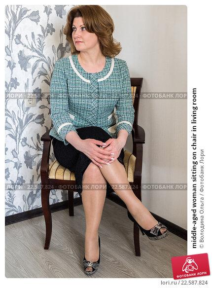 Купить «middle-aged woman sitting on chair in living room», фото № 22587824, снято 24 марта 2015 г. (c) Володина Ольга / Фотобанк Лори
