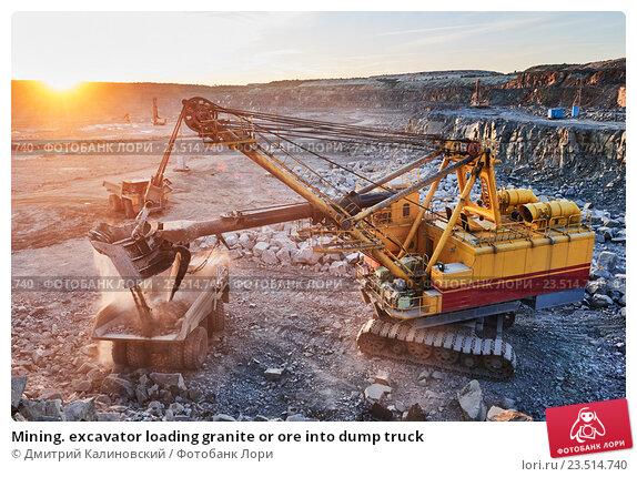 Купить «Mining. excavator loading granite or ore into dump truck», фото № 23514740, снято 8 сентября 2016 г. (c) Дмитрий Калиновский / Фотобанк Лори