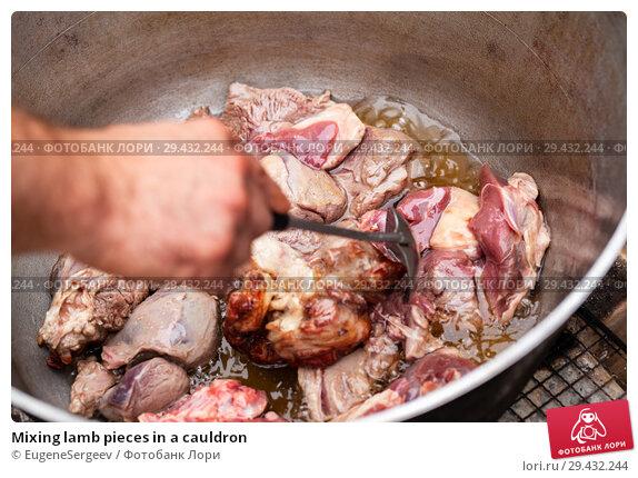 Купить «Mixing lamb pieces in a cauldron», фото № 29432244, снято 23 сентября 2018 г. (c) EugeneSergeev / Фотобанк Лори