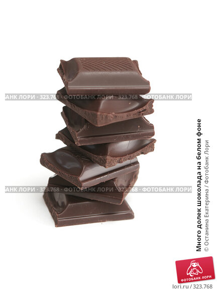 Много долек шоколада на белом фоне, фото № 323768, снято 21 ноября 2007 г. (c) Останина Екатерина / Фотобанк Лори