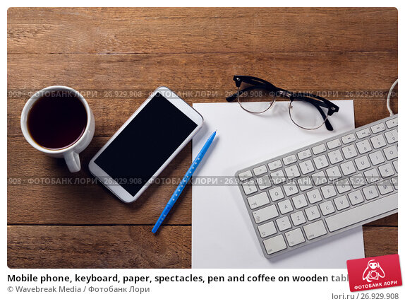 Mobile phone, keyboard, paper, spectacles, pen and coffee on wooden table, фото № 26929908, снято 26 мая 2017 г. (c) Wavebreak Media / Фотобанк Лори