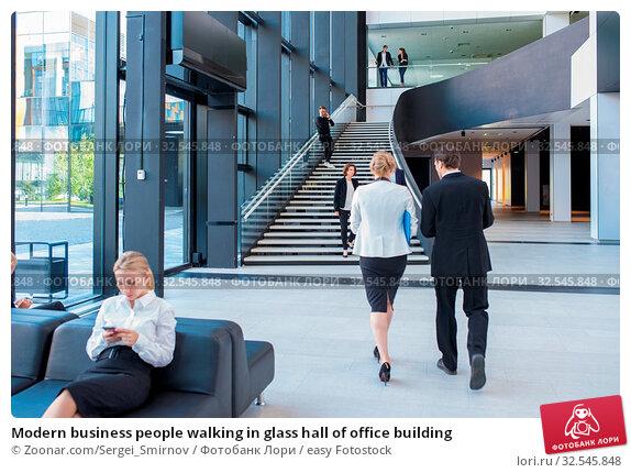 Купить «Modern business people walking in glass hall of office building», фото № 32545848, снято 7 декабря 2019 г. (c) easy Fotostock / Фотобанк Лори