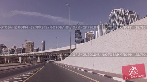 Купить «Modern road junctions in Dubai stock footage video», видеоролик № 28790848, снято 8 апреля 2018 г. (c) Юлия Машкова / Фотобанк Лори