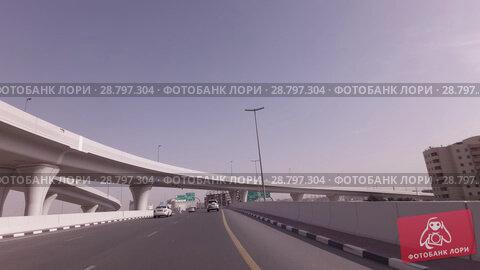 Купить «Modern road junctions in Dubai stock footage video», видеоролик № 28797304, снято 8 апреля 2018 г. (c) Юлия Машкова / Фотобанк Лори