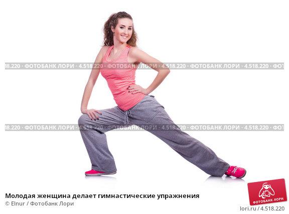 Купить «Молодая женщина делает гимнастические упражнения», фото № 4518220, снято 5 марта 2013 г. (c) Elnur / Фотобанк Лори