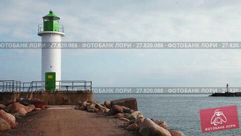 Купить «Morning view of lighthouses, the gate to Ventspils sea port, Latvia», видеоролик № 27820088, снято 10 сентября 2016 г. (c) Алексей Кузнецов / Фотобанк Лори