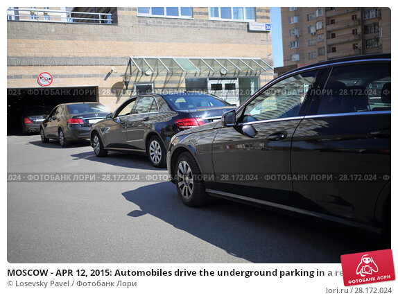 Купить «MOSCOW - APR 12, 2015: Automobiles drive the underground parking in a residential complex Elk Island», фото № 28172024, снято 12 апреля 2015 г. (c) Losevsky Pavel / Фотобанк Лори