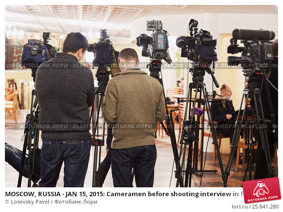 Купить «MOSCOW, RUSSIA - JAN 15, 2015: Cameramen before shooting interview in foyer of Moscow theatre Et Cetera after media preview of Boris Godunov directed by Peter Stein», фото № 25841280, снято 15 января 2015 г. (c) Losevsky Pavel / Фотобанк Лори