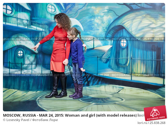 MOSCOW, RUSSIA - MAR 24, 2015: Woman and girl (with model releases) look at fairytale houses in optical illusions Museum at VDNKh. Редакционное фото, фотограф Losevsky Pavel / Фотобанк Лори