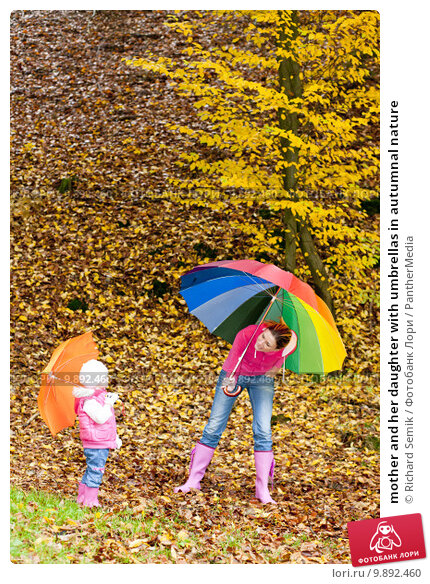 Купить «mother and her daughter with umbrellas in autumnal nature», фото № 9892460, снято 23 февраля 2019 г. (c) PantherMedia / Фотобанк Лори