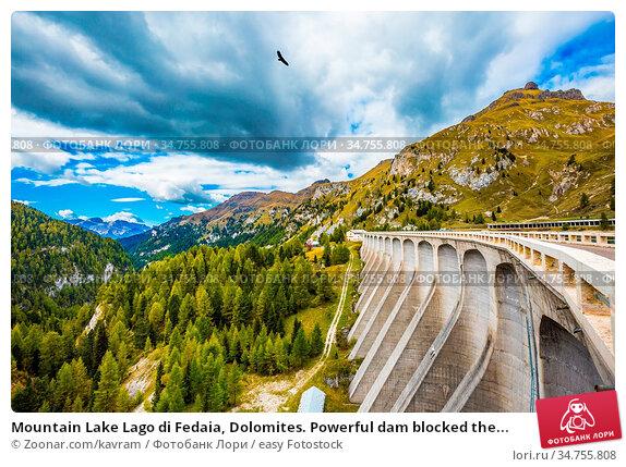 Mountain Lake Lago di Fedaia, Dolomites. Powerful dam blocked the... Стоковое фото, фотограф Zoonar.com/kavram / easy Fotostock / Фотобанк Лори