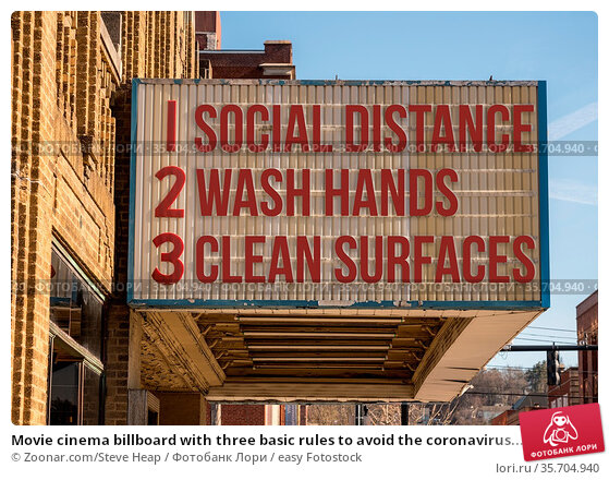 Movie cinema billboard with three basic rules to avoid the coronavirus... Стоковое фото, фотограф Zoonar.com/Steve Heap / easy Fotostock / Фотобанк Лори