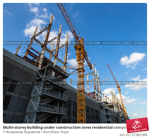 Multi-storey building under construction (new residential complex on the territory of the former ZIL plant), Moscow, Russia, фото № 27083908, снято 24 октября 2016 г. (c) Владимир Журавлев / Фотобанк Лори