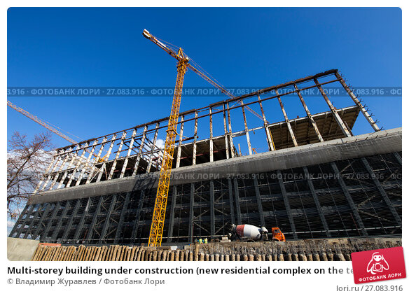 Multi-storey building under construction (new residential complex on the territory of the former ZIL plant), Moscow, Russia, фото № 27083916, снято 24 октября 2016 г. (c) Владимир Журавлев / Фотобанк Лори