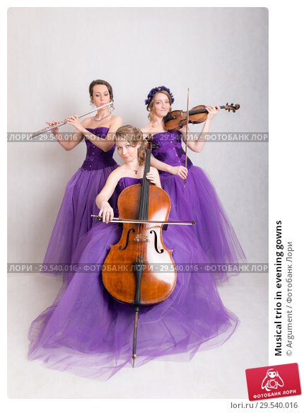Купить «Musical trio in evening gowns», фото № 29540016, снято 30 апреля 2015 г. (c) Argument / Фотобанк Лори
