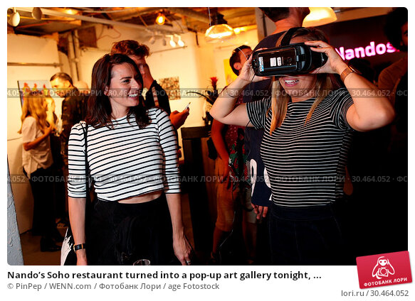 Nando's Soho restaurant turned into a pop-up art gallery tonight, ... (2017 год). Редакционное фото, фотограф PinPep / WENN.com / age Fotostock / Фотобанк Лори