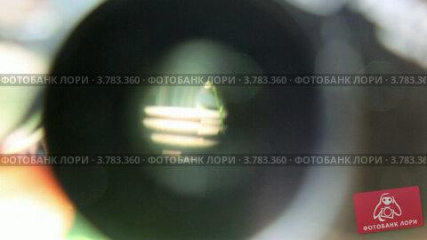 Направленный глазок бинокля, вид крупным планом, видеоролик № 3783360, снято 5 мая 2012 г. (c) Losevsky Pavel / Фотобанк Лори