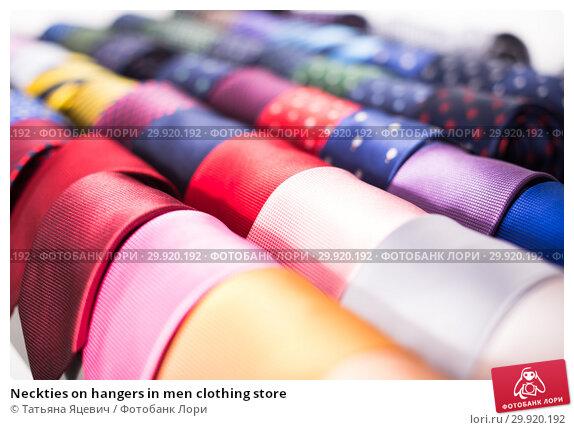 Купить «Neckties on hangers in men clothing store», фото № 29920192, снято 20 июня 2017 г. (c) Татьяна Яцевич / Фотобанк Лори