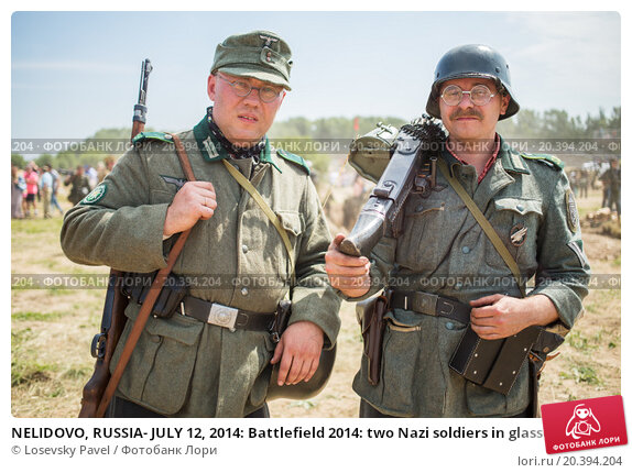 Купить «NELIDOVO, RUSSIA- JULY 12, 2014: Battlefield 2014: two Nazi soldiers in glasses with arms», фото № 20394204, снято 12 июля 2014 г. (c) Losevsky Pavel / Фотобанк Лори