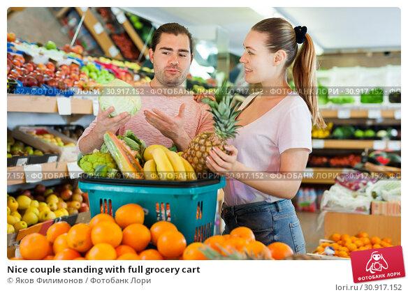 Купить «Nice couple standing with full grocery cart», фото № 30917152, снято 27 апреля 2019 г. (c) Яков Филимонов / Фотобанк Лори