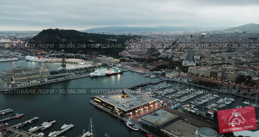 Купить «Night aerial view from drones of old port in Barcelona with of sailboats and yachts and gothic quarter, historical part of the city», видеоролик № 30386268, снято 1 сентября 2018 г. (c) Яков Филимонов / Фотобанк Лори