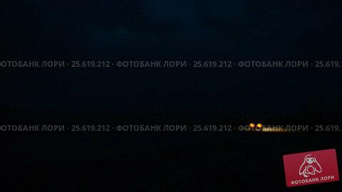 Купить «Night storm out of the city and the cars on the night road», видеоролик № 25619212, снято 26 февраля 2017 г. (c) Mikhail Erguine / Фотобанк Лори