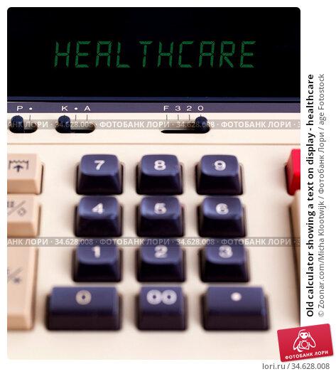 Old calculator showing a text on display - healthcare. Стоковое фото, фотограф Zoonar.com/Micha Klootwijk / age Fotostock / Фотобанк Лори
